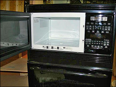 Ge Recalls 92 000 Microwaves Cbs News