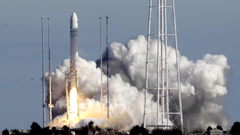 Antares rocket climbs into space on maiden flight - CBS News