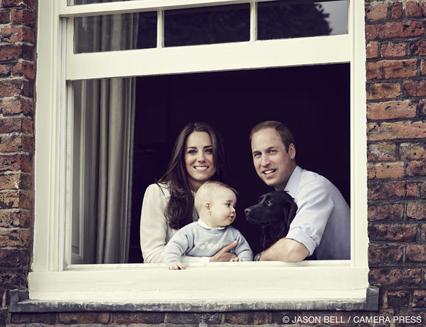 Prince William, Duke of Cambridge, Catherine, Duchess of Cambridge, and Prince George of Cambridge pose for an official family portrait at Kensington Palace ahead of their tour to Australia and New Zealand March 18, 2014, in London. Also pictured is their