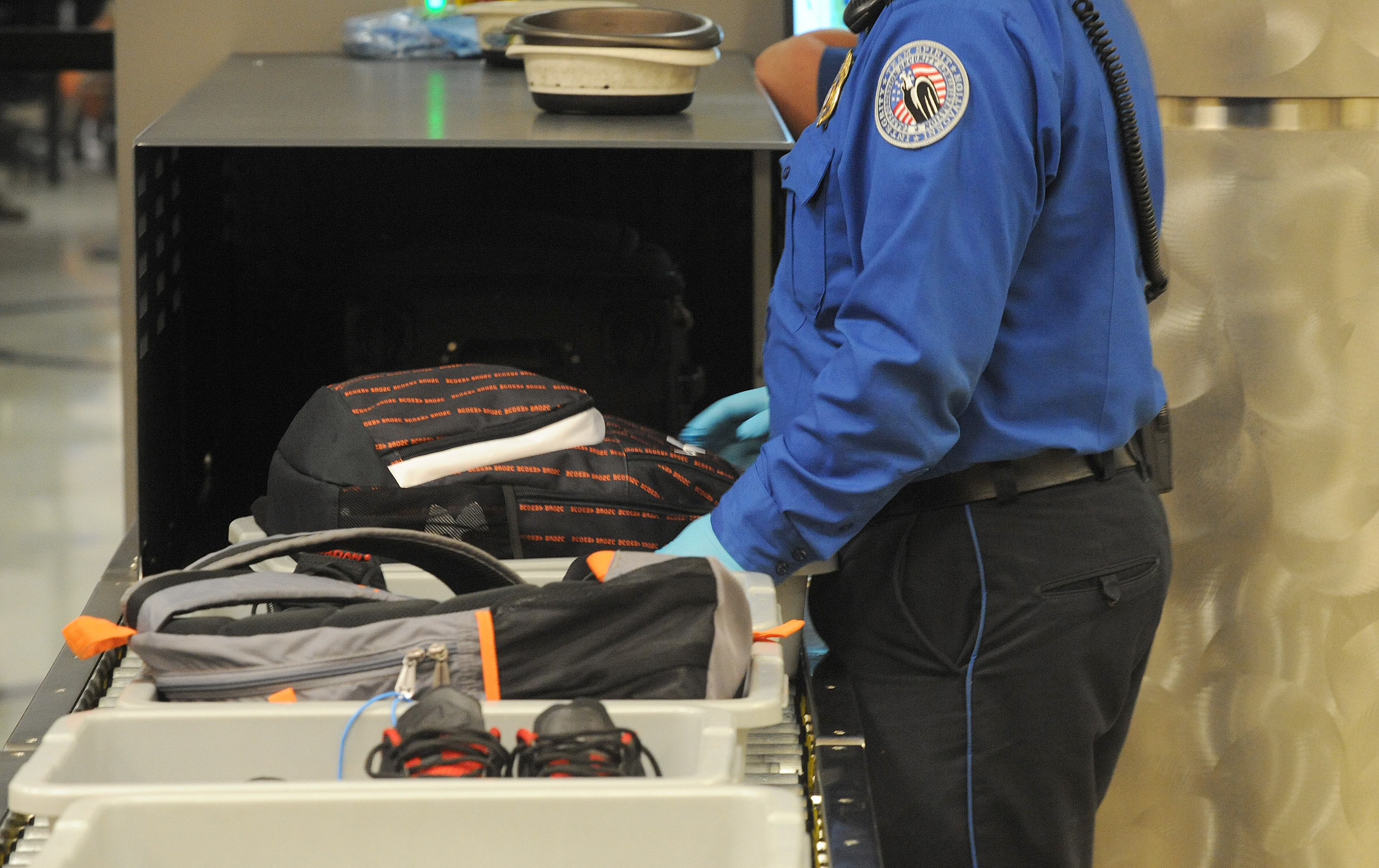 faa employee arrested after flying with gun in carry