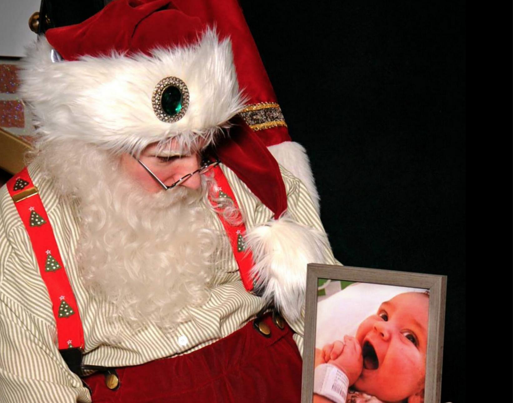 Santa Claus Sitting In A Chair Santa Claus Sitting In A