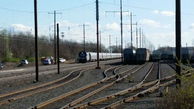 Amtrak train strikes backhoe and derails
