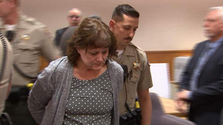 ​Jane Laut is escorted from the courtroom after the verdict