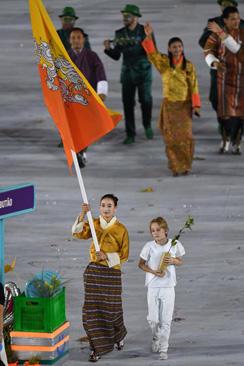bhutan-flagbearer-karma-getty-586322134.jpg