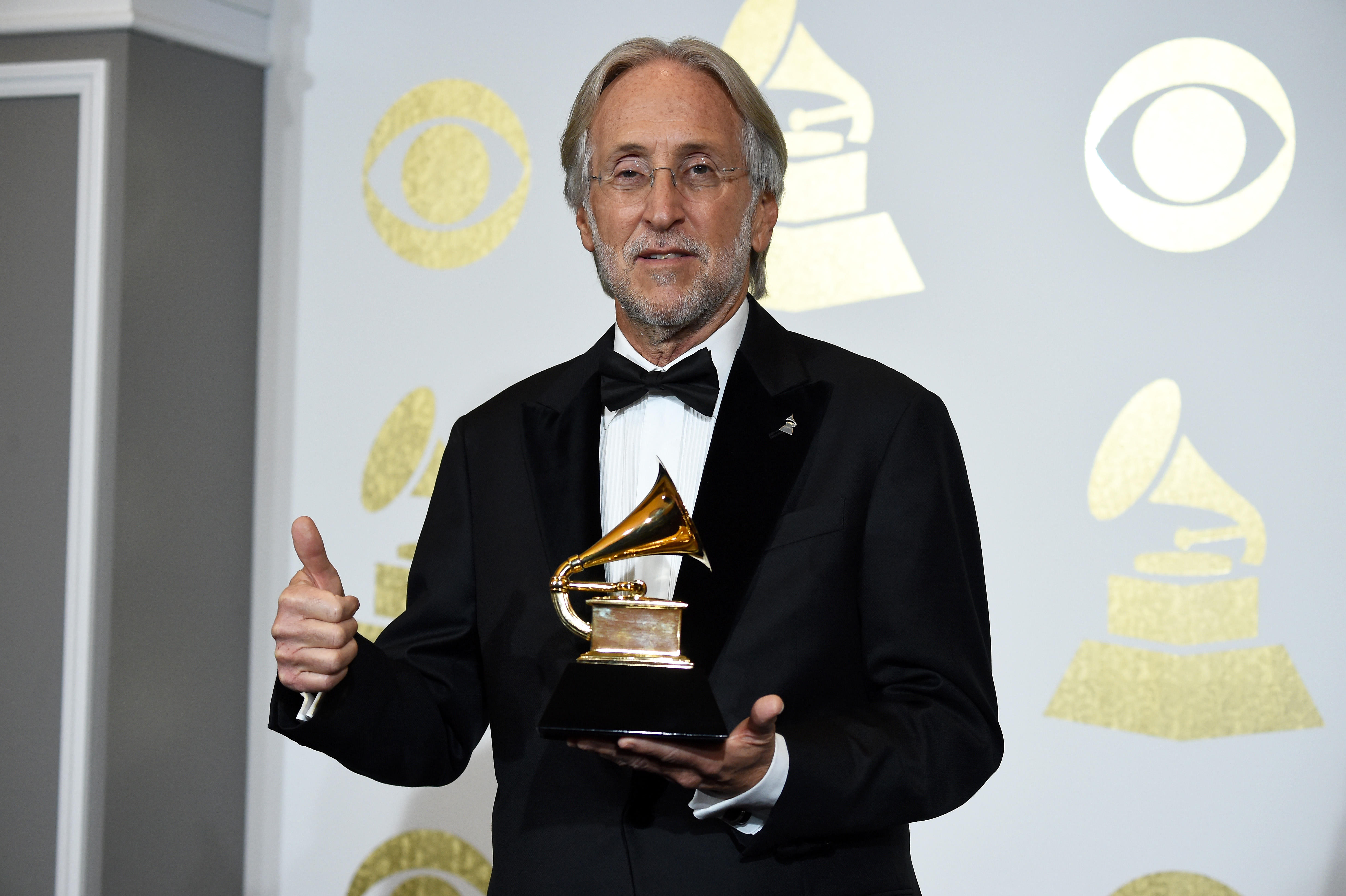 46b29b9113b8 President CEO of The Recording Academy and Grammy Foundation President CEO  Neil Portnow speaks in the press room during the The 59th Grammy Awards on  ...