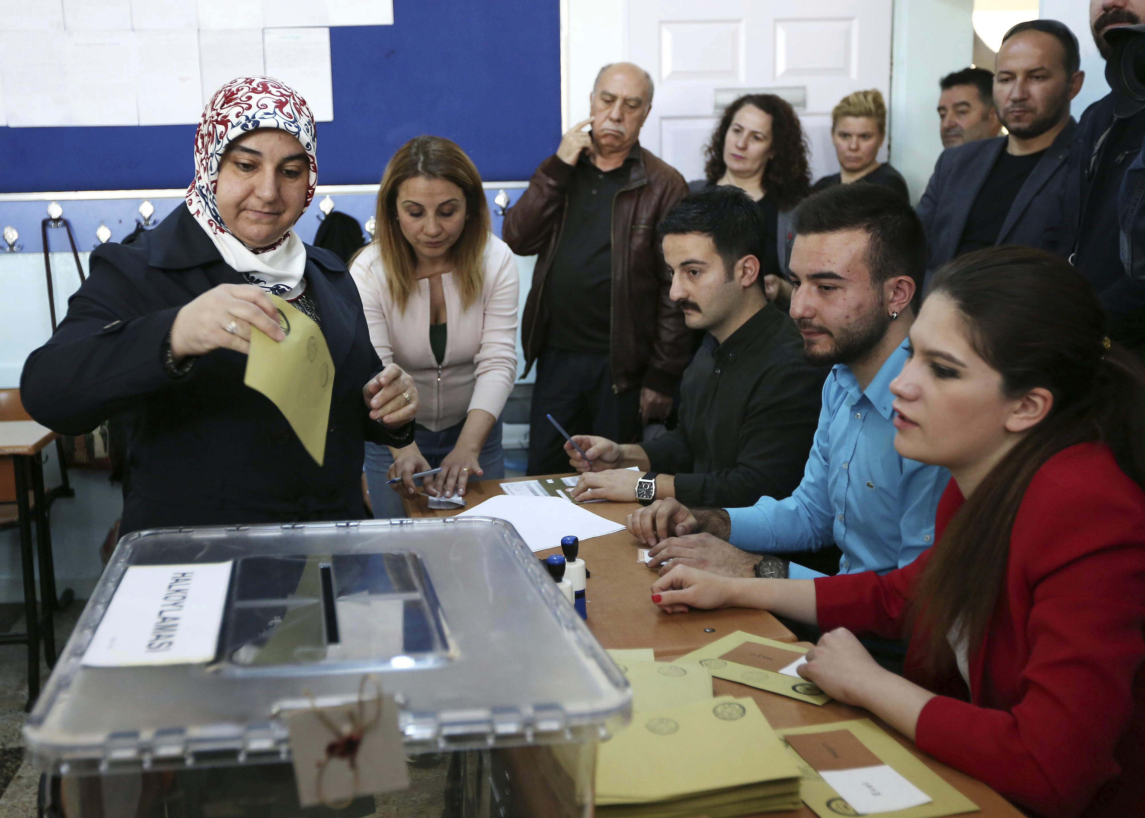 A Turkish woman casts her ballot at a polling station in Ankara 6b0cec2761ee