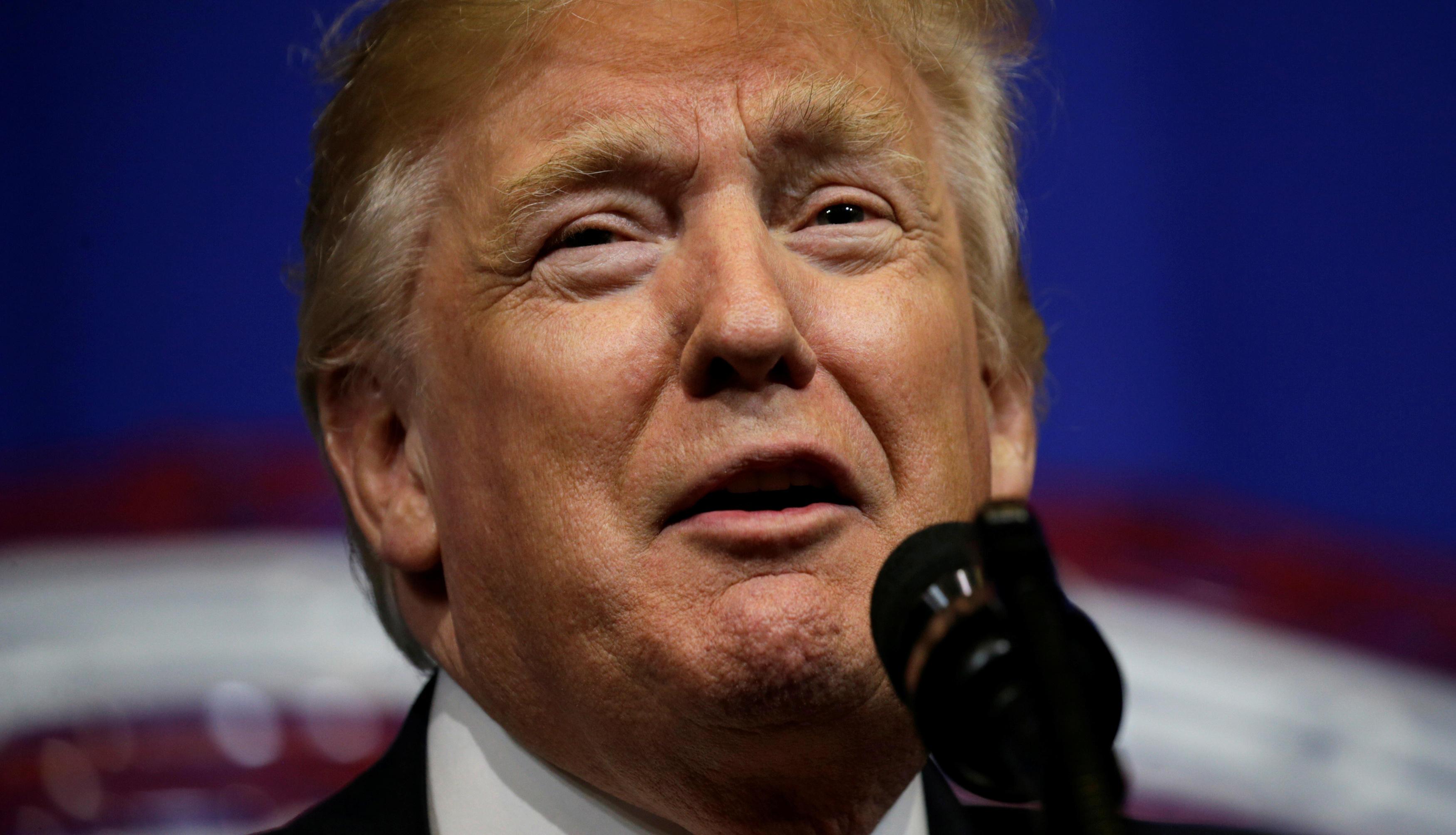 photo image Trump calls 100-day assessment
