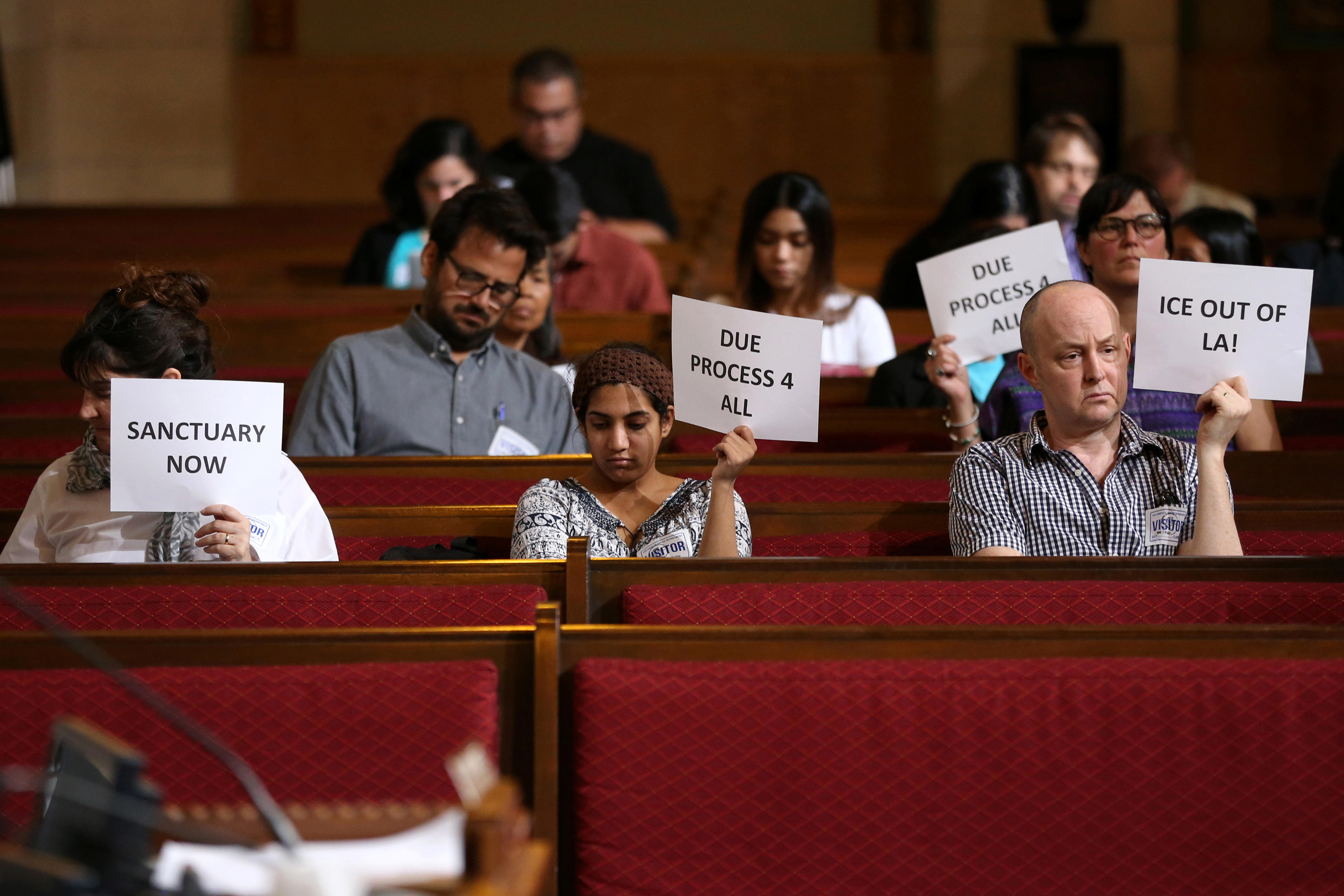 7b2572dd88d Immigrant supporters protest during the Los Angeles City Council ad hoc  committee on immigration meeting to discuss the city s response to threats  by the ...
