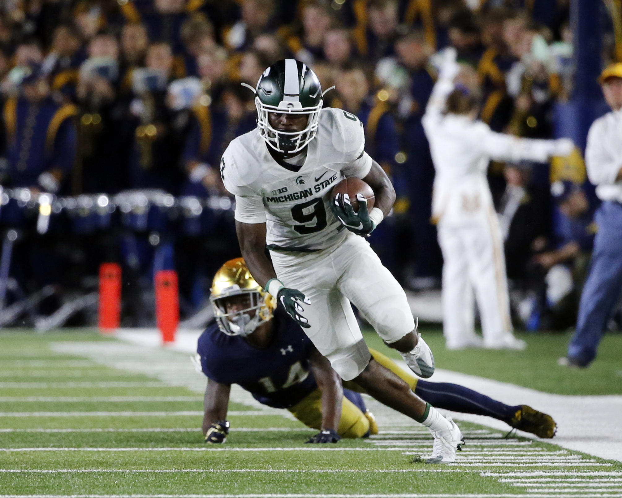 players football michigan state assault against corley charges freshman team field filed case ap spartans offense defense charged helping college