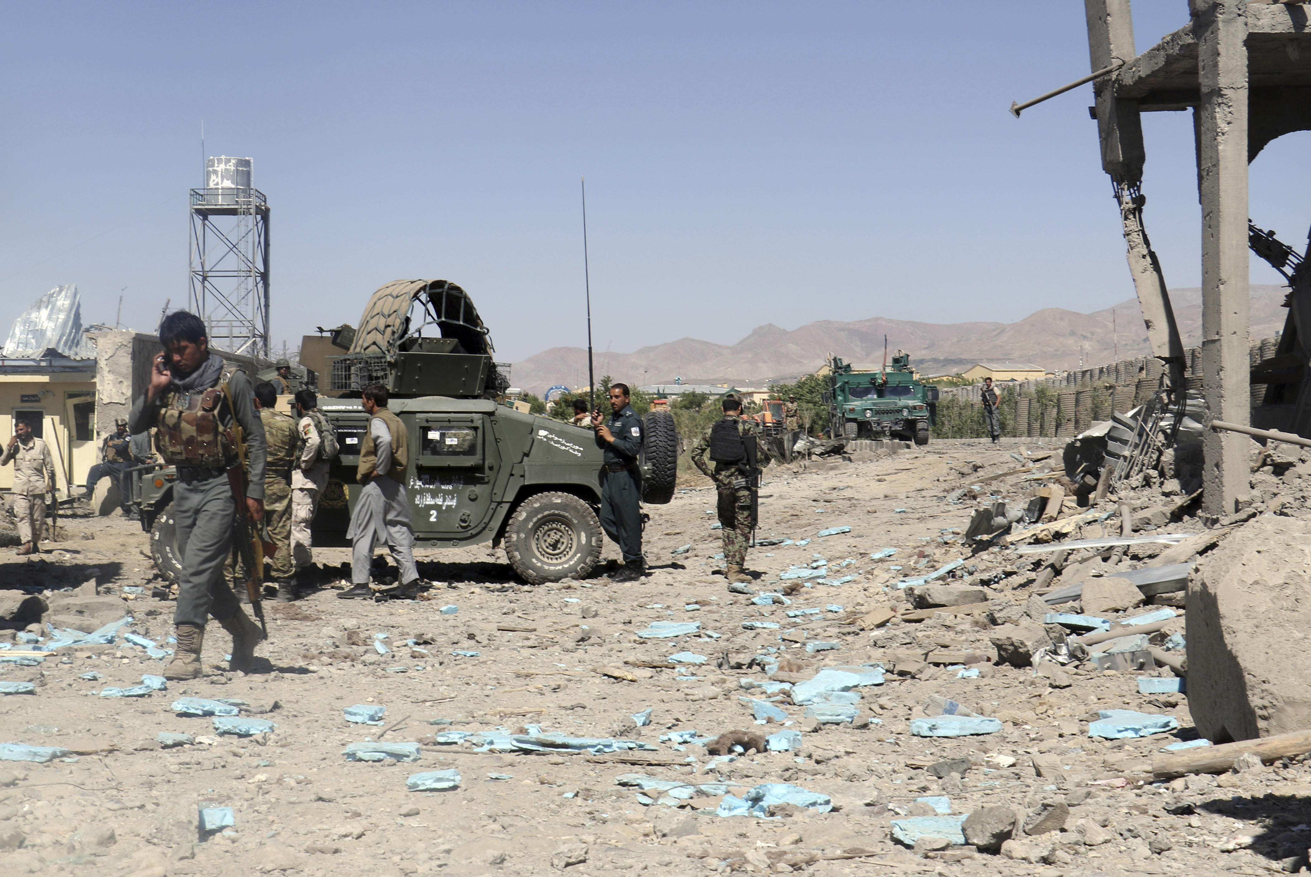 KABUL, Afghanistan -- The Taliban stormed a police headquarters in eastern Afghanistan on Sunday after striking it with two suicide car bombs, ...