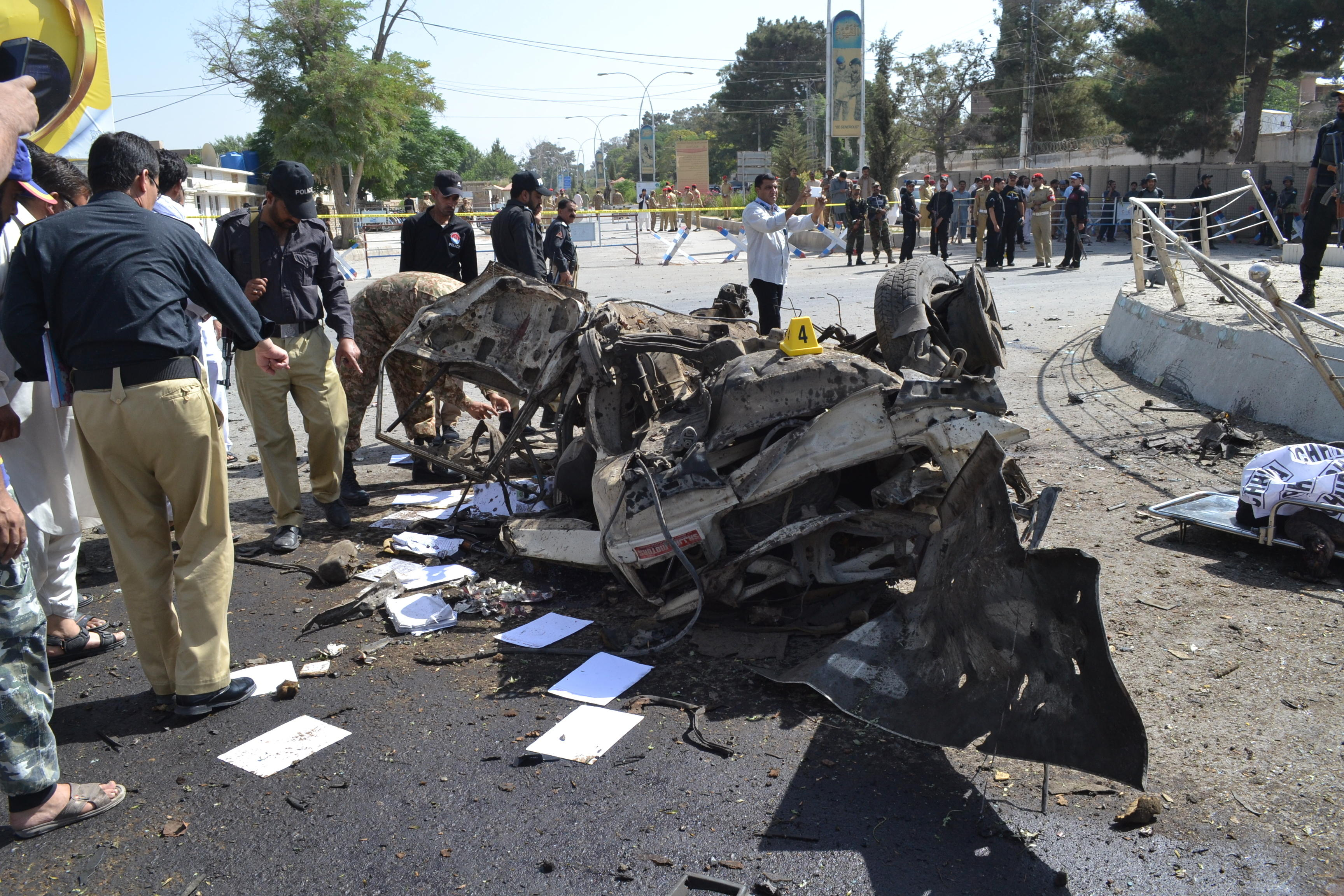 40 people killed in bomb and gun attacks across 3 cities