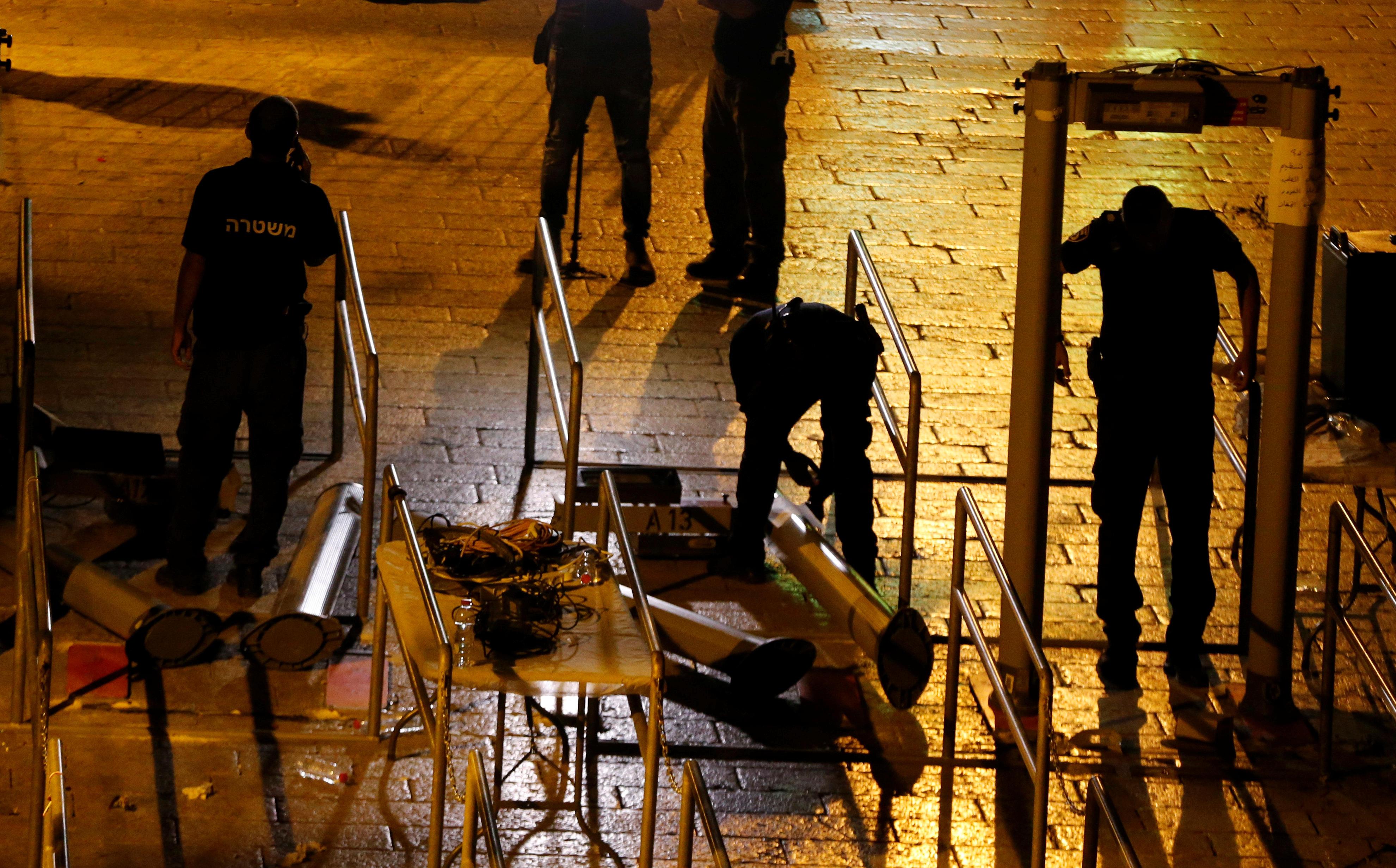 Israel starts removing metal detectors from Jerusalem holy site