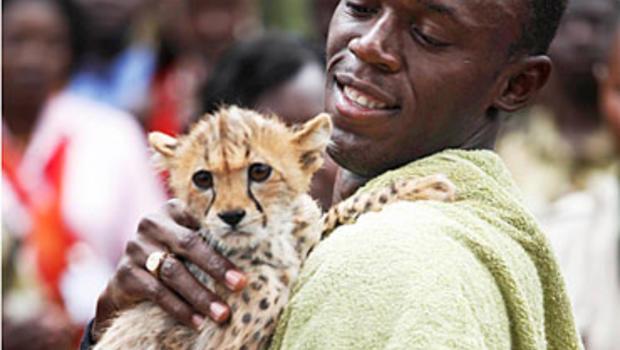 World's Fastest Man Adopts its Fastest Cat - CBS News