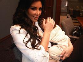 Kim Kardashian holding her nephew Mason.