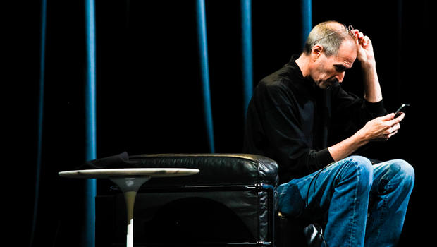On stage at WWDC, Steve Jobs sits down to give a demo of the new FaceTime video calling feature.