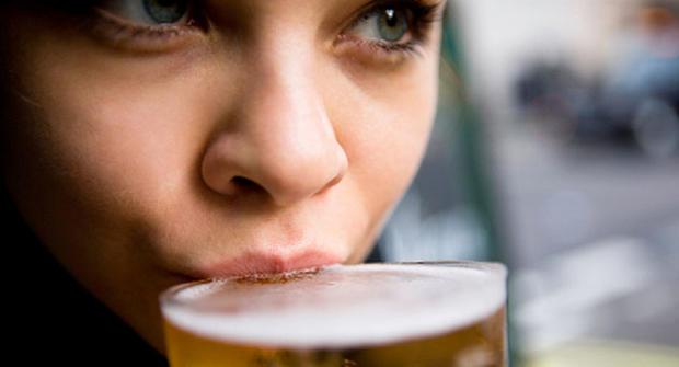 woman drinking beer, generic, stock