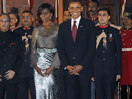 S. First Lady Michelle Obama, reacts, at Rashtrapati Bhavan, or President's Palace in New Delhi, India, Monday, Nov. 8, 2010. Indian and U.S. companies have discussed or signed over $14.9 billion in deals around Obama's trip, which will support 53,670 U.S. jobs, the White House said. (AP Photo/Manish Swarup)