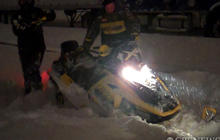 Chasing Stories on a Snowmobile
