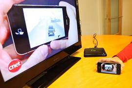 Snapstick in action on an iPhone 4 and TV monitor.