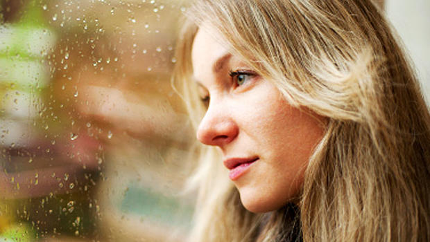 woman, sad, window, seasonal affective disorder, istockphoto, 4x3