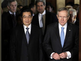 China's President Hu Jintao walks with Senate Majority Leader Harry Reid of Nev. on Capitol Hill in Washington, Thursday, Jan. 20, 2011. Senate Foreign Relations Committee Chairman Sen. John Kerry, D-Mass. is at center. (AP Photo/Carolyn Kaster)