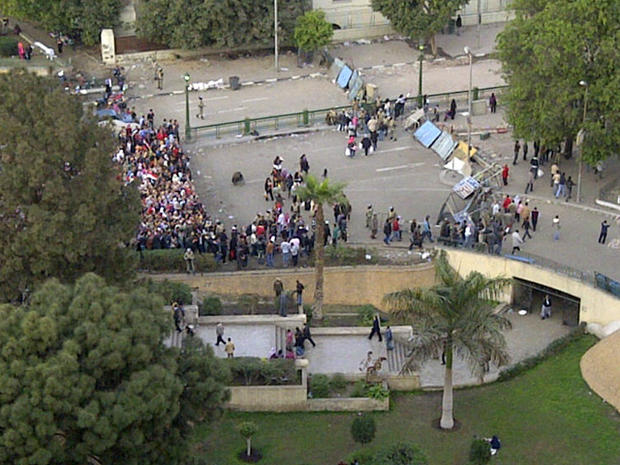 Protesters queue up to go through the military and protester checkpoints