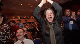 Pamela Sanderon, of Lansing, Mich., jumps out of her seat while cheering for Rep. Ron Paul