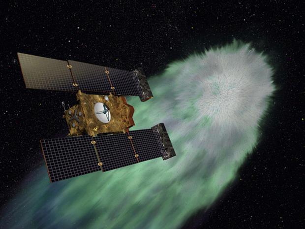 Artist illustration of NASA's Stardust-NExT spacecraft  approaching comet Tempel1