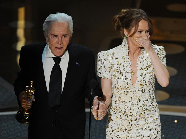 Kirk Douglas with Melissa Leo after Leo won Best Supporting Actress during the 83rd Annual Academy Awards.
