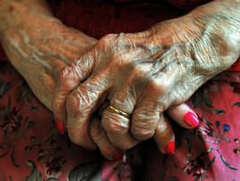 hands of an elderly resident at a nursing home