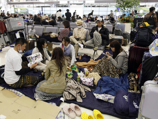 Passengers rest on the floor of the Narita International Airport, March 12, 2011.