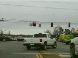 Two escaped murder suspects drive their stolen pick-up through a red light as Mississippi and Tennessee police give chase, March 14, 2011