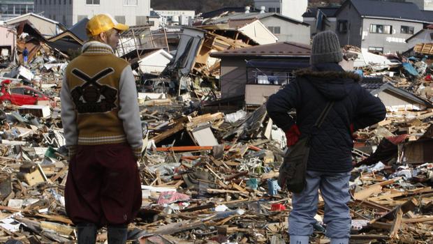 Residents survey tsunami damage in Miyagi Prefecture, Japan