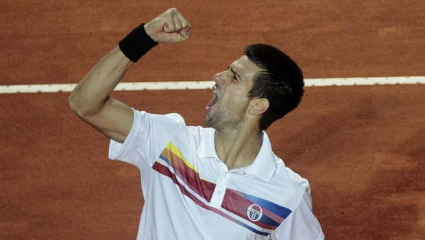 Serbia's Novak Djokovic celebrates at the end of the final match against Spain's Rafael Nadal at the Italian Open tennis tournament in Rome, Sunday, May 15, 2011.
