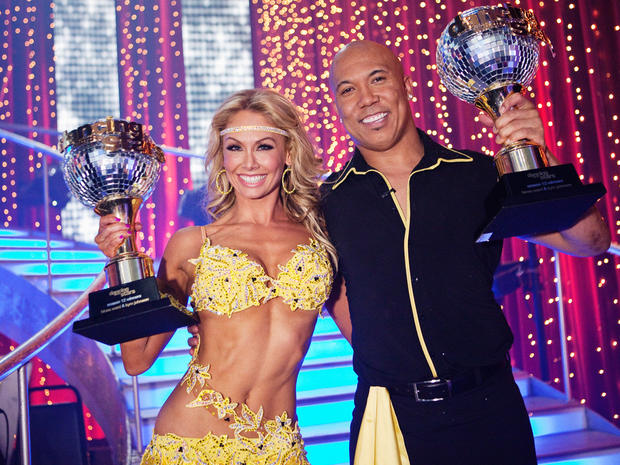 "Hines Ward and Kym Johnson pose with their trophies after they were named ""Dancing with the Stars"" champions on May 24, 2011."