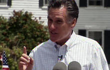 Romney defends his legislative record