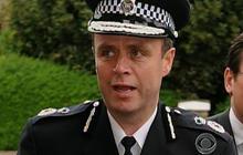 Top cop taken down in phone hacking scandal