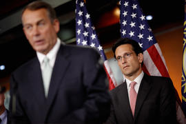 House Majority Leader Eric Cantor (R-VA) listens to Speaker of the House John Boehner (R-OH) during a news conference