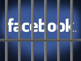 Facebook logo behind prison bars