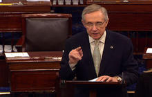 Debt clock ticks, Sen. Reid moves ahead with his own plan