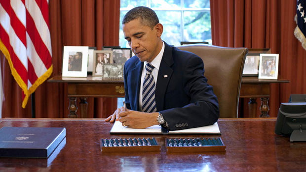 President Barack Obama signs the Budget Control Act