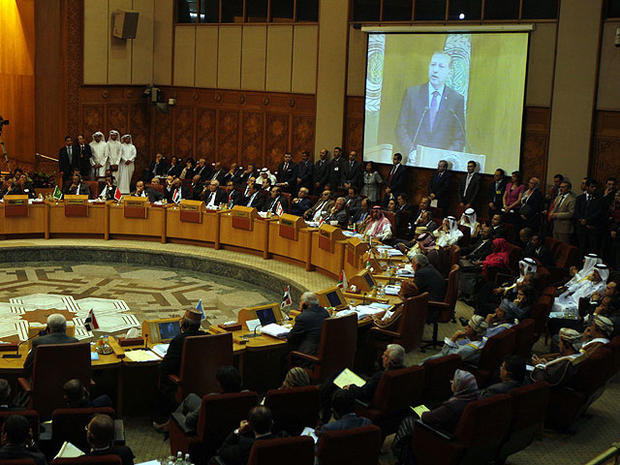 Turkish prime minister Recep Tayyip Erdogan is seen on a screen as he gives a speech to the Arab league members during an Arab league meeting in its headquarters in Cairo, Egypt, Sept. 13, 2011.