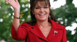 Former Alaska Gov. Sarah Palin waves during a Tea Party Express rally Sept. 5, 2011, in Manchester, N.H.