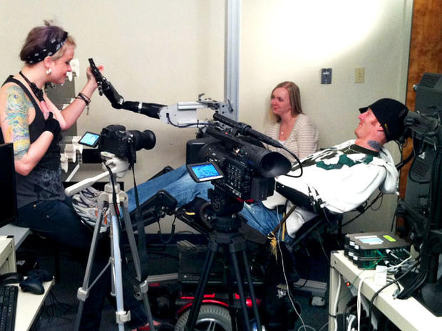 Robotic arm lets paralyzed man touch girlfriend