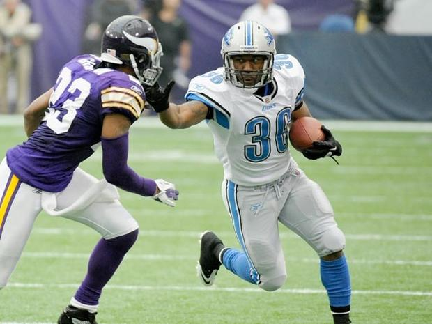 MINNEAPOLIS, MN - SEPTEMBER 25: Cedric Griffin #23 of the Minnesota Vikings looks to tackle as Jerome Harrison #36 of the Detroit Lions carries the ball in the third quarter on September 25, 2011 at Hubert H. Humphrey Metrodome in Minneapolis, Minnesota. The Lions defeated the Vikings 26-23. (Photo by Hannah Foslien/Getty Images)