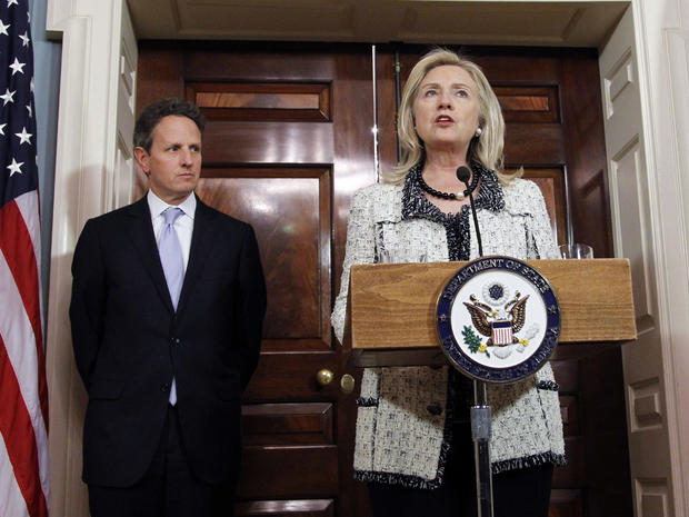 Secretary of State Hillary Rodham Clinton, speaks as Treasury Secretary Tim Geithner listens