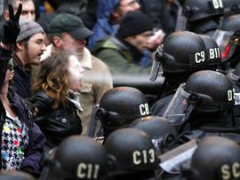 A police officer uses pepper spray on an Occupy Portland protester at Pioneer Courthouse Square in Portland, Ore., Nov. 17, 2011.