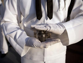 Urn with the ashes of Pearl Harbor survivor Lee Soucy, held by Navy Region Hawaii Honor Guard