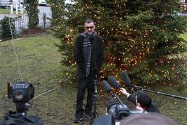 After being hospitalized for pneumonia, George Michael arrives back at his home in London on Dec. 23, 2011.
