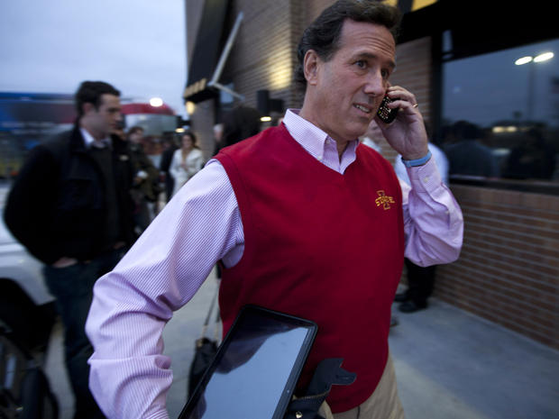Former Pennsylvania Sen. Rick Santorum talks on the phone after a campaign stop Dec. 30, 2011, in Ames, Iowa.